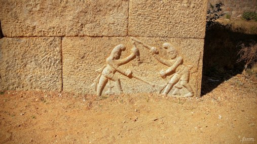 Carvings depicting sword fight practice